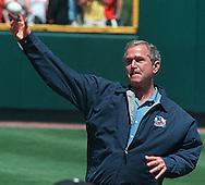 President Geroge Bush throws out the first pitch of the 2001 College World Series. (photo by Chris Machian/Prairie Pixel Group)