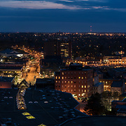 Panorama of Downtown Guelph at night. The Basilica of Our Lady, City Hall, the Sleeman Centre, MacDonell street, Paisley street, Quebec street, Baker street, Woolwich street, the Speed River, and the Heffernan street walking bridge.