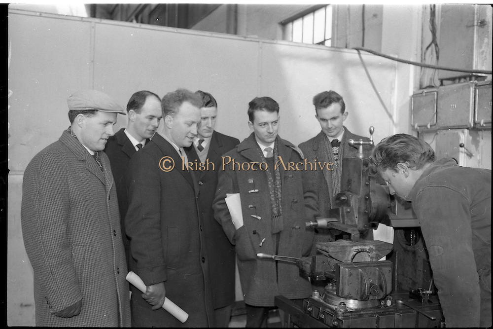 21/02/1963.02/21/1963.21 February 1963.Teachers tour Bord na Mona workshops. Vocational school teachers, whose past pupils include Bord na Mona apprntices, were guests at three of the Board's workshops., to study the organisation of the workshops and watch apprntices on the job. Watching Senior Apprentice E.Heaney at work were teachers (l-r) M. Reen (Athy V.S.), B. Clancy (Lanesboro' V.S.), A. Egan (Portarlington V.S.) and R. Hatton (Kilucan V.S.) at Derrygreenagh.