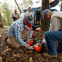 Thomas Wells | BUY AT PHOTOS.DJOURNAL.COM<br /> Michael Palmer, left, and Max Hutchinson start filling the chainsaws with fuel and oil before they begin a chainsaw certification class on West Jackson Street Wednesday morning.