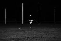 Aussie Rules footballer Glenn Boyd kicks through the big sticks and into the darkness during a Crib Point Magpies training session ahead of their Nepean Football Netball League Grand Final match between against the Sorrento Sharks on September 20, 2014 in Hastings, Australia. (Copyright Michael Dodge/Getty Images)