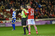 Luke Thomas of Barnsley FC pleads with referee Keith Stroud during the EFL Sky Bet Championship match between Barnsley and Queens Park Rangers at Oakwell, Barnsley, England on 14 December 2019.