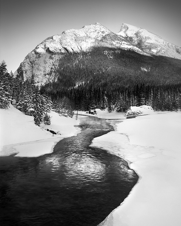Last Light hitting Mount Rundle and reflecting back on the Bow River at Bow Falls.