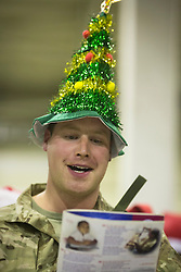 24/12/2013. Craftsmen Phil McKinsley (28) joins troops in Camp Bastion in Afghanistan as they begin the festive celebrations this with an evening carol concert.  Photo credit: Alison Baskerville/LNP