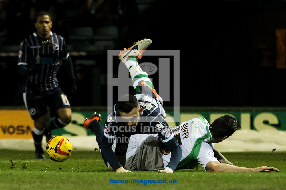 Shane Duffy (right) of Yeovil Town tackles Scott Malone (centre) of Millwall during the Sky Bet Championship match at Huish Park, Yeovil<br /> Picture by Tom Smith/Focus Images Ltd 07545141164<br /> 11/02/2014