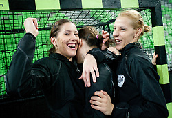 Andrea Seric and Gorica Acimovic of Krim celebrate after the handball match between RK Krim Mercator and Larvik HK (NOR) of Women's EHF Champions League 2011/2012, on November 13, 2011 in Arena Stozice, Ljubljana, Slovenia. Larvik defeated Krim 22-19 but both teams qualified to new round. (Photo By Vid Ponikvar / Sportida.com)