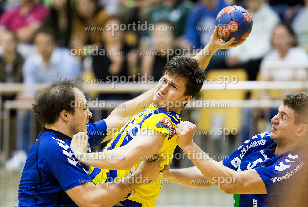 David Razgor of RK Celje PL vs Grega Krecic of RD Koper 2013 and Nino Grzentic of RD Koper 2013 during handball match between RK Celje Pivovarna Lasko and RD Koper 2013 in Final of Slovenian Men Handball Cup 2015/16, on April 17, 2016 in Ribnica, Slovenia. Photo by Vid Ponikvar / Sportida
