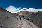 Hikers climb up Cotopaxi volcano in Ecuador, one of the highest active volcanoes in the world.