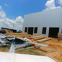 Sunshine Pharmacy of Nettleton awaits being bricked up ahead of its anticipated mid-September opening. It is among a number of new businesses Monroe County residents can anticipate in coming months.