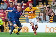 Oliver Bozanic (#7) of Heart of Midlothian and Richard Tait (#2) of Motherwell FCduring the Ladbrokes Scottish Premiership match between Motherwell and Heart of Midlothian at Fir Park, Motherwell, Scotland on 15 September 2018.