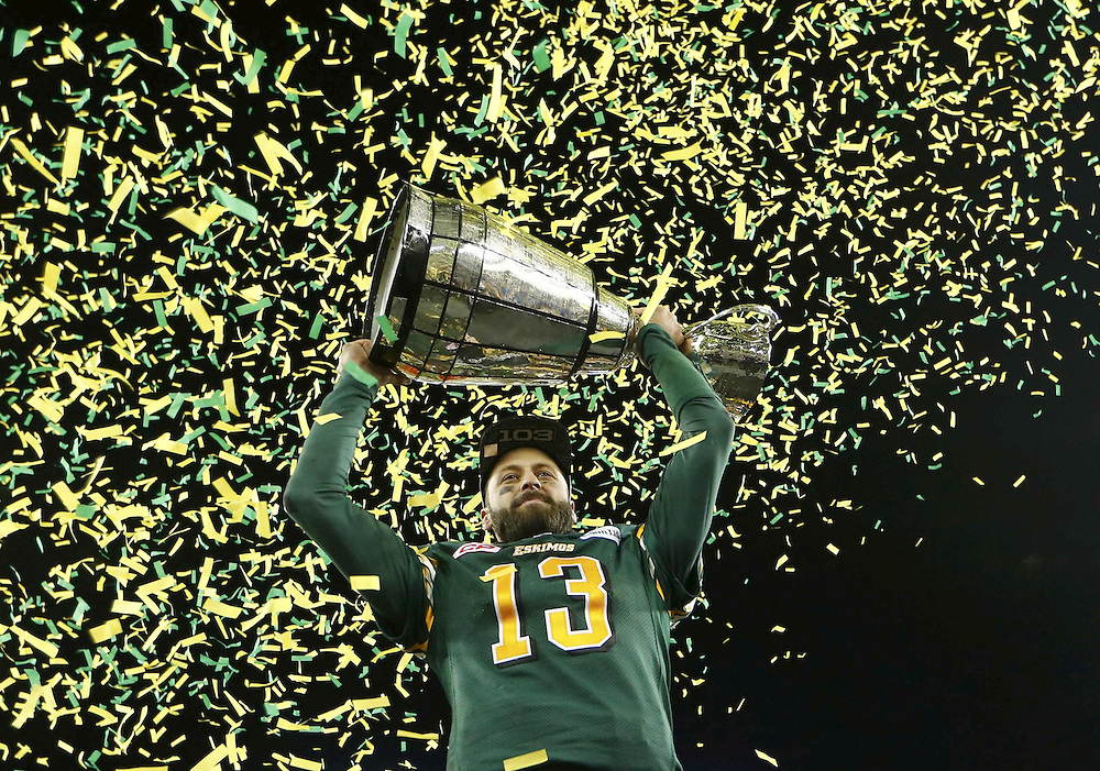 Edmonton Eskimos quarterback Mike Reilly raises the Grey Cup after his team defeated the Ottawa Redblacks in the CFL's 103rd Grey Cup championship football game in Winnipeg, Manitoba, November 29, 2015.  REUTERS/Mark Blinch       TPX IMAGES OF THE DAY      - RTX1WJ84