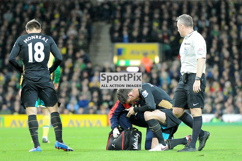 Arsenals Laurent Koscielny receives treatment for an injury which ultimately ends his game during the Norwich v Arsenal game in the Barclays Premier League on Sunday 29th November 2015 at Carrow Road