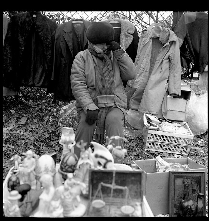 Bazar Olimpia in Warsaw, Poland, February 2008. every Sunday morning homeless, alcoholics and unemployed people gather at the so-called Olimpia Bazar to expose their poor things on the bare ground and try to sell them.