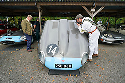 © Licensed to London News Pictures. <br /> 13/09/2019. <br /> Goodwood.West, Sussex. UK.<br /> The Goodwood Motor Circuit celebrates the 21st year of the Revival.This has become one of the biggest annual historic motorsport events in the world and the only one to be staged entirely in period dress. Each year over 150,000 people descend on this quiet corner of West Sussex to enjoy the three-day event.<br /> Pictured A photographer takes a close up.<br /> Photo credit: Ian Whittaker/LNP
