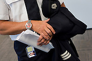 Safe pair of pilot's hands holds flight documents in the British Airways Crew Report Centre at Heathrow Airport's Terminal 5.