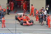 Scuderia Ferrari pit lane activity showing Kimi Raikkonen leaving the garage in warm up for the Canadian Grand Prix.