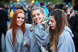 © Licensed to London News Pictures.  01/05/2015. OXFORD, UK. OXFORD, UK. Students walk down High St in Oxford on May Morning. Each year at 6am the Magdalen College Choir performs the Hymnus Eucharisticus, from the top of Magdalen Tower, a tradition dating back over 500 years. Around 6,000 students and local residents, some of who have stayed up all night, gather in the street below to listen.  Photo credit: Cliff Hide/LNP