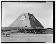 America's pyramid: Photos reveal the Egyptian-esque missile facility used by the U.S. military to detect and launch ICBMs<br /> <br /> Anyone traveling through Nekoma, North Dakota - a stone's throw from the Canadian border on the way to the exact middle of nowhere - might be shocked to find an enormous pyramid jutting above the horizon. As well they should be - this is North Dakota, not Egypt.<br /> But this American pyramid was once home to one of the United States military's anti-ballistic missile defense system with the Cold War-era goal of shooting down Soviet missiles before they ever reached their intended targets - and likely killing thousands of Americans.<br /> The Nekoma pyramid is part of a cluster of military facilities once known as the Stanley R. Mickelsen Safeguard Complex, named after U.S. Army Air Defense Commanding General Stanley Mickelsen.<br /> <br /> Construction of the Complex was completed in 1975. The Complex's pyramid served as its Missile Site Radar base that essentially scanned all directions in search of airborne objects that may pose a threat to the U.S.<br /> The pyramid-shaped radar facility was complete with 30 Spartan missiles and 16 of the shorter-range Sprints missiles, all of which were held in underground launch silos.<br /> The location of the pyramid is cryptically explained as 'Northeast of Tactical Road; southeast of Tactical Road South' - a sparsely populated section of one of the most sparsely populated states in the U.S.<br /> As a whole, the Complex was armed with launch and control pads for 30 LIM-49 Spartan anti-ballistic missiles, and 70 shorter-range Sprint anti-ballistic missiles in support of the Army's Safeguard anti-ballistic missile program.<br /> On February 10, 1976, the site was officially deactivated - after less than a year of being operational.<br /> The Library of Congress, however, has a stunning set of images that shows the various states of construction and completion.<br /> The photos were taken for the government by photographer Benjammin Halpern<br /> ©Library of Congress/E