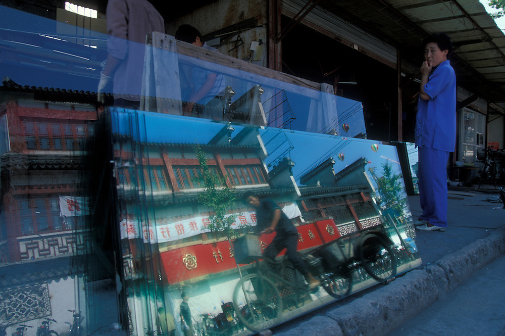 China, Jiangzi Province, Nanjing, Passing traffic reflected in glass shop's windows in Fuzi Miao district