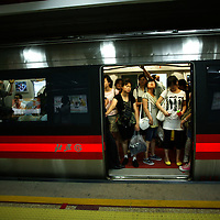 BEIJING, JULY-27  : passengers ride in one of the newly built subway lines.