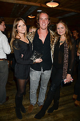 Left to right, MILLY WILSON, MICHAEL WALKER and LUCY BRANTLY at 'Bodo's Schloss Goes Wild For Lewa' held at Bodo's Schloss, 2A Kensington High St, London W8 on 9th October 2013.