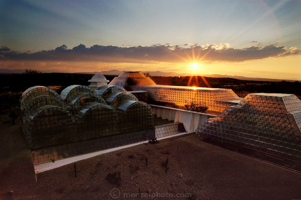 Model of Biosphere 2 Project buildings photographed at sunset on the building site. At the time this photo was taken, ground had not been broken yet for the main building. The Biosphere was a privately funded experiment, designed to investigate the way in which humans interact with a small self-sufficient ecological environment, and to look at possibilities for future planetary colonization. 1990