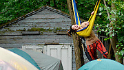 Devin Miyazaki, of Fort Collins, Col., struggles to climb into a hammock strung about eight feet above the ground at Summer Camp 2013 at Three Sisters Park in Chillicothe.