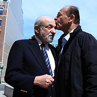 (Boston, MA - 4/3/17) Suffolk County Register of Probate Felix D. Arroyo gets a kiss from supporter John B. Cruz III, president of Cruz Construction, following Arroyo's news conference regarding his suspension and subsequent investigation outside the Brooke Courthouse, Monday, April 03, 2017. Staff photo by Angela Rowlings.