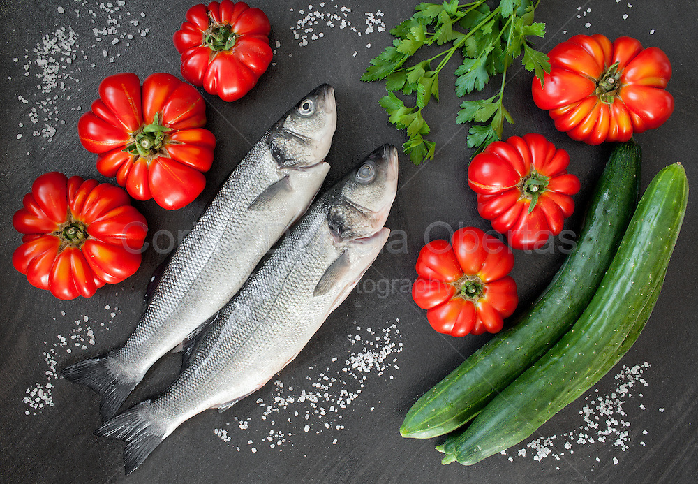 Fresh sea bass with tomatoes, cucumbers and fresh parsley.