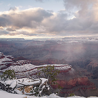 Grand Canyon at Yavapai Point Overlook with snowy layers and snow shower