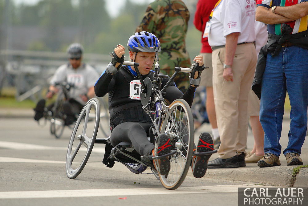 July 4th, 2006:  Anchorage, Alaska - Jonathan Merchant (582), a Army veteran from Fort Worth, Texas, enters turn one of the 5k handcycle event at the 26th National Veterans Wheelchair Games..