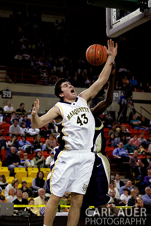 25 November 2005: Marquette Golden Eagle Ryan Amoroso, a sophomore forward, has his shot blocked by a ORU player in the Marquette University 73-70 victory over Oral Roberts University at the Great Alaska Shootout in Anchorage, Alaska.