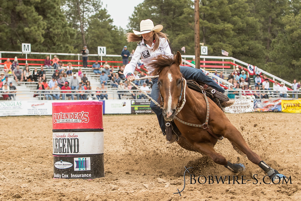 Amanda Harris makes her barrel racing run during the third performance of the Elizabeth Stampede on Sunday, June 3, 2018.