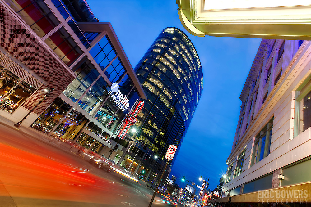 View south down Main Street in downtown Kansas City, MIssouri. Traffic motion blur and the H&R Block headquarters tower.