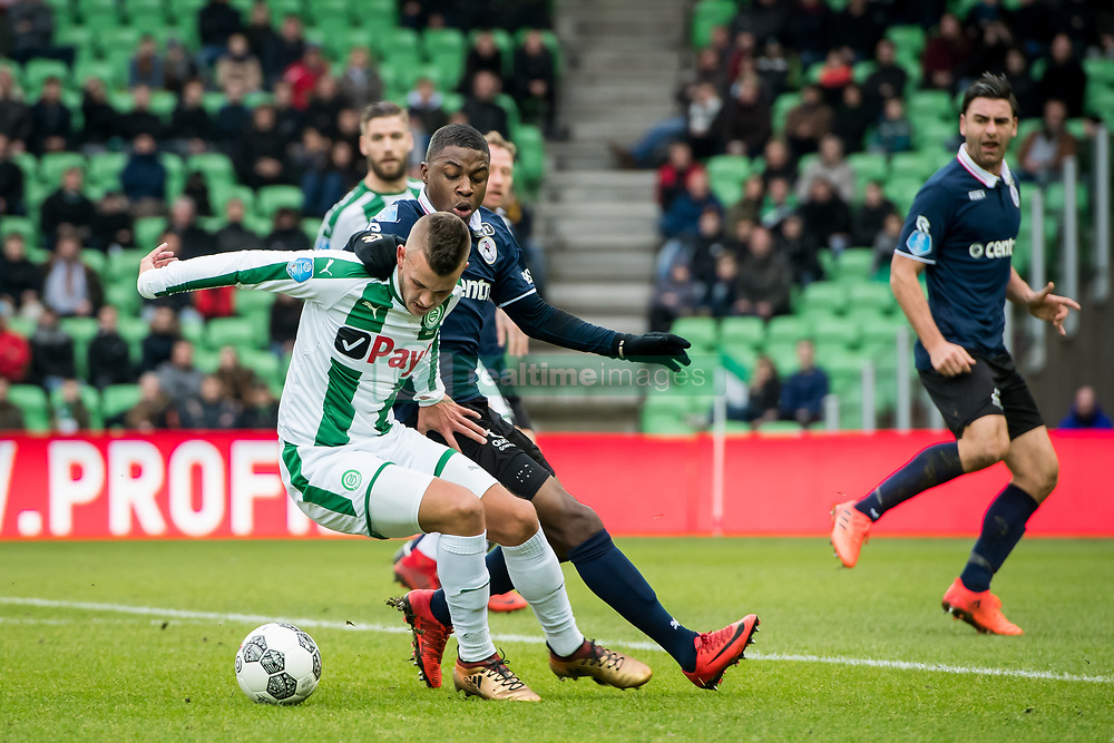 (L-R) Jesper Drost of FC Groningen, Sherel Floranus of Sparta Rotterdam during the Dutch Eredivisie match between FC Groningen and Sparta Rotterdam at Noordlease stadium on December 24, 2017 in Groningen, The Netherlands