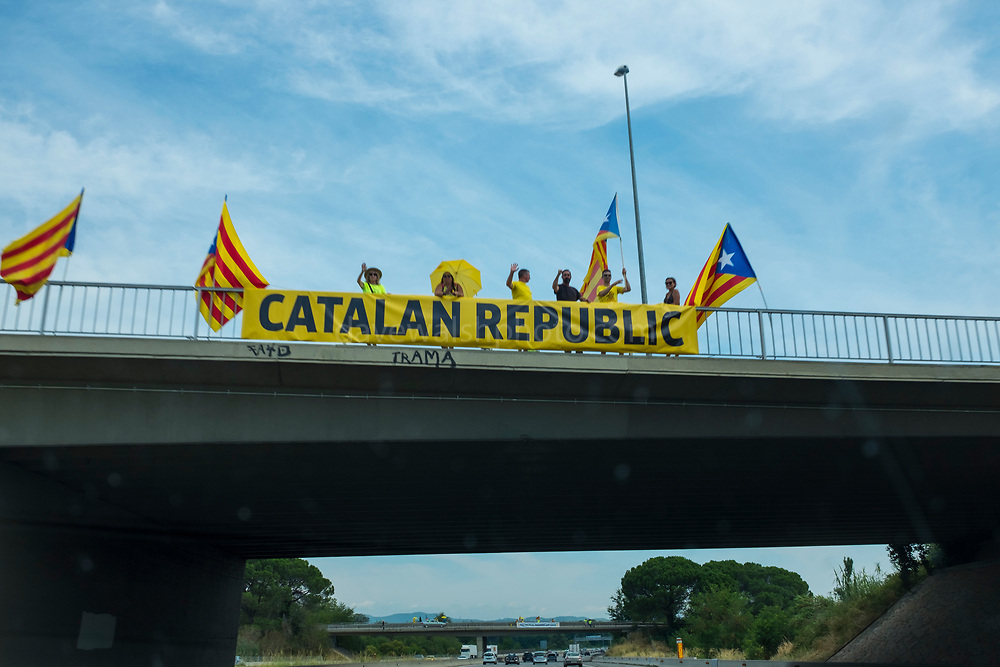 Pro-Catalan independence activists on flyovers used banners and flags to pronounce the Catalan republic and call for the release of political prisoners to tourists travelling on the AP-7/E-15 Motorway in Catalonia, on one of the busiest holiday weekends of the year - July 28, 2018.