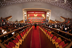 A Chinese security officer guarding the entrance to the audience seats during the opening session of the National Peoples Congress (NPC) in the Great Hall of the People in Beijing, China, on 05 March 2011. The NPC has over 3,000 delegates and is the world's largest parliament or legislative assembly though its function is largely as a formal seal of approval for the policies fixed by the leaders of the Chinese Communist Party.
