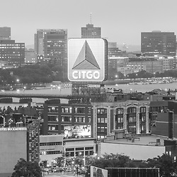 Panoramic Boston skyline aerial black and white photo with the Citgo sign, Fenway Park, Kenmore Square, Harvard Bridge, and the Charles River. Boston Massachusetts is a major city in the Eastern United States of America. Panoramic photo ratio is 1:3. Copyright ⓒ Paul Velgos with All Rights Reserved.