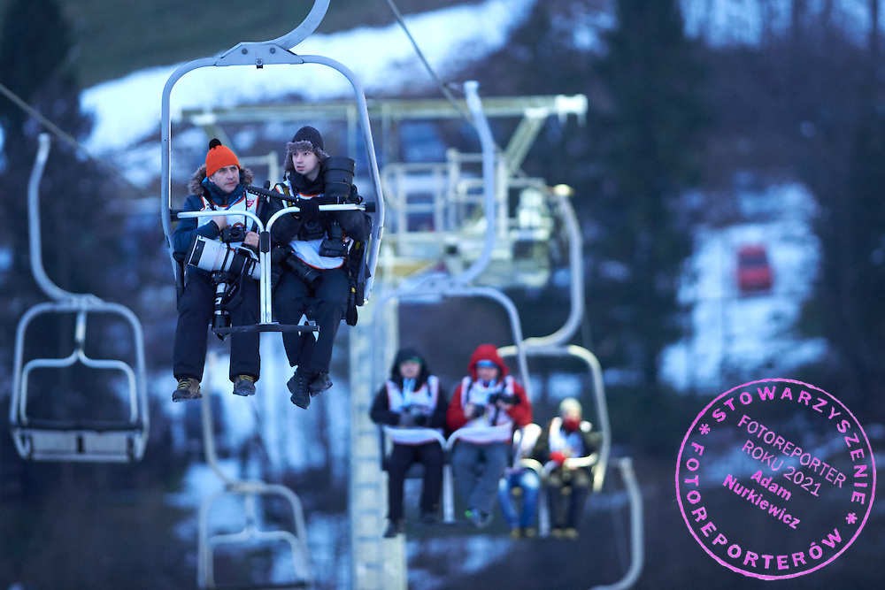 (L) Photographer Andrzej Iwanczuk (Reporter Agency) and (R) photographer Rafal Oleksiewicz (Pressfocus Agency) sit in ski lift during FIS World Cup Ski Jumping competition in Wisla, Poland on January 15, 2015.<br /> <br /> Poland, Wisla, January 15, 2015.<br /> <br /> Picture also available in RAW (NEF) or TIFF format on special request.<br /> <br /> For editorial use only. Any commercial or promotional use requires permission.<br /> <br /> Mandatory credit:<br /> Photo by &copy; Adam Nurkiewicz / Mediasport