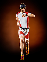 one caucasian  man runner running  triathlon ironman isolated