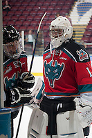 KELOWNA, CANADA - SEPTEMBER 20: Jesse Lees #2 and Jackson Whistle #1 of Kelowna Rockets share a laugh on the ice after the win against the Kamloops Blazers on September 20, 2014 at Prospera Place in Kelowna, British Columbia, Canada.   (Photo by Marissa Baecker/Shoot the Breeze)  *** Local Caption *** Jesse Lees; Jackson Whistle;