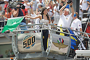 Olympic gold medalist and Dancing with the Stars winner Kristi Yamaguchi waves the green flag to start the 92nd running of the Indianapolis 500 on May 25, 2008. Photo by Michael Hickey