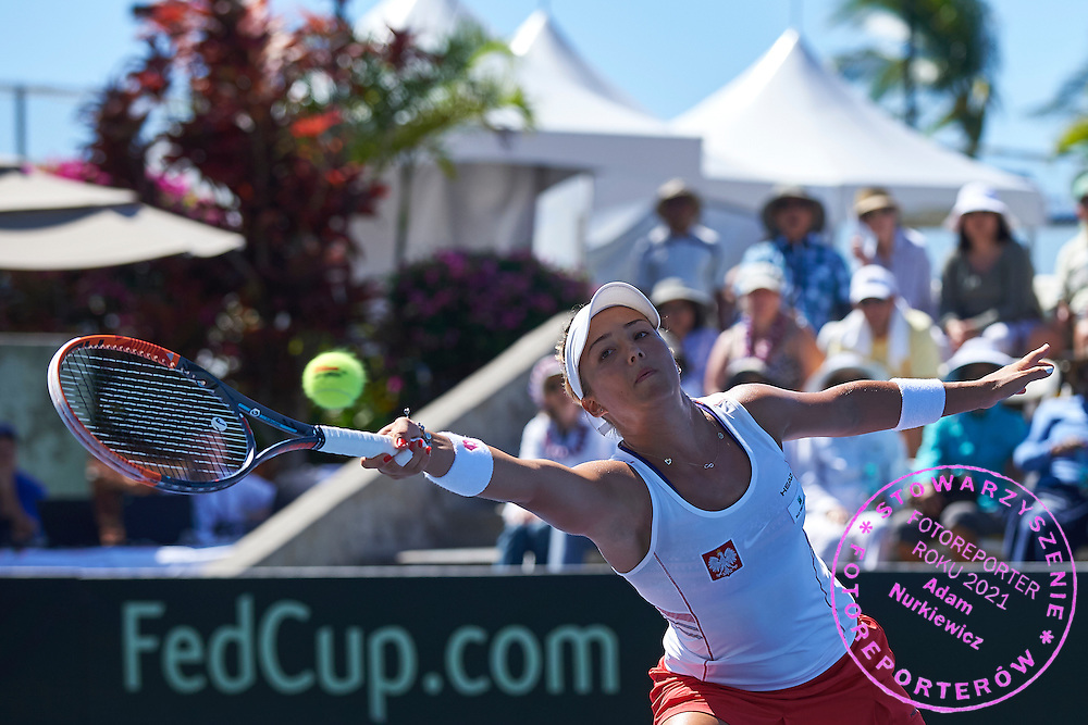 KAILUA KONA, USA - 2016 FEBRUARY 07: Paula Kania from Poland competes at women's double during the Fed Cup World Group II 1st round tennis match between USA and Poland on February 07, 2016 at Holua Tennis Center in Kailua Kona, USA.<br /> <br /> Picture also available in RAW (NEF) or TIFF format on special request.<br /> <br /> Any editorial, commercial or promotional use requires written permission from the author of image.<br /> <br /> Adam Nurkiewicz declares that he has no rights to the image of people at the photographs of his authorship.<br /> <br /> Mandatory credit:<br /> Photo by &copy; Adam Nurkiewicz / Mediasport