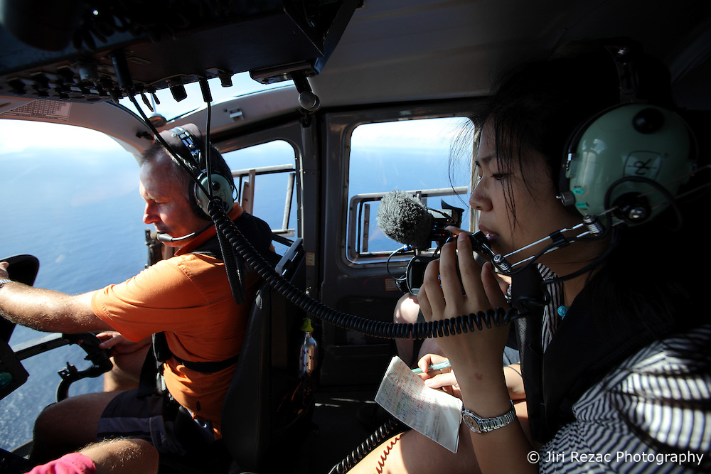 INDIAN OCEAN 27APR13 - Translator Lizzy Chen Ling-Chen of Taiwan communicates via the helicopter's radio with a Taiwanese-registered longliner in the Indian Ocean.<br /> <br /> The Greenpeace ship Esperanza is on patrol documenting fishing activities in the Indian Ocean.<br /> <br /> jre/Photo by Jiri Rezac / Greenpeace