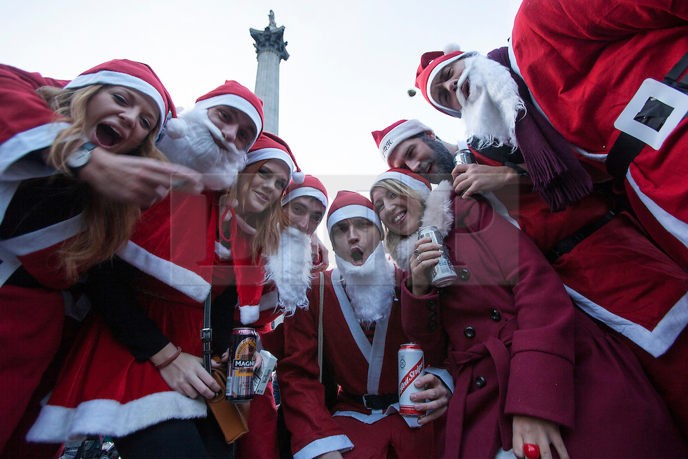 © licensed to London News Pictures. London, UK 15/12/2012. Hundreds of people dressed as 'Santa' meeting at Trafalgar Square, London to celebrate an early Christmas. Photo credit: Tolga Akmen/LNP