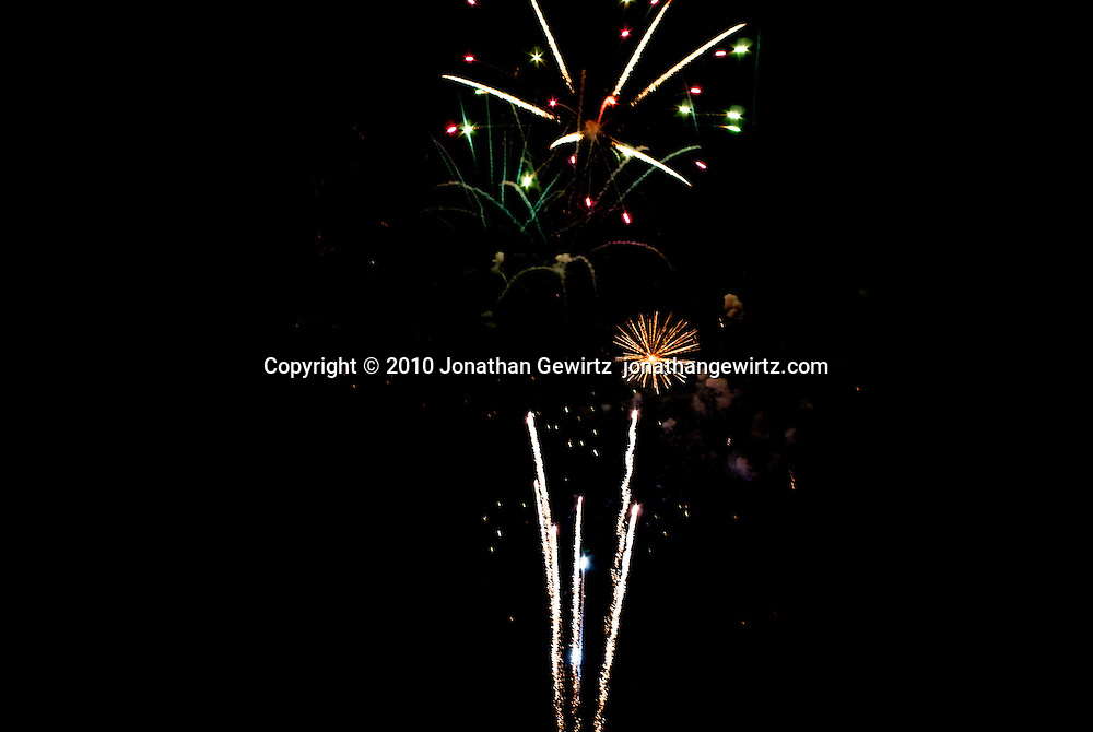 Colorful fireworks bursts at night. WATERMARKS WILL NOT APPEAR ON PRINTS OR LICENSED IMAGES.