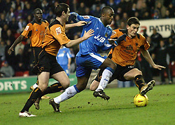 WIGAN, ENGLAND - Tuesday, January 4, 2005: Wolverhampton Wanderers' Keith Andrews and Wigan's Nathan Ellington during the League Championship match at the JJB Stadium. (Pic By Dave Kendall/Propaganda)
