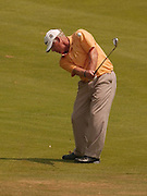 2007 Boyne Tournament of Champions competitor Bob Ackerman hits his approach shot on the 16th hole of Boyne Mountains Alpine course.