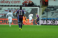 Swansea city's Jonathan De Guzman (20) shoots and scores his sides 3rd goal.  Barclays premier league, Swansea city v Stoke city at the Liberty Stadium in Swansea on Saturday 19th Jan 2013. pic by Andrew Orchard, Andrew Orchard sports photography,