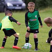 U8 Players play a competitive game during the Avenue Utd Summmer Soccer Camp